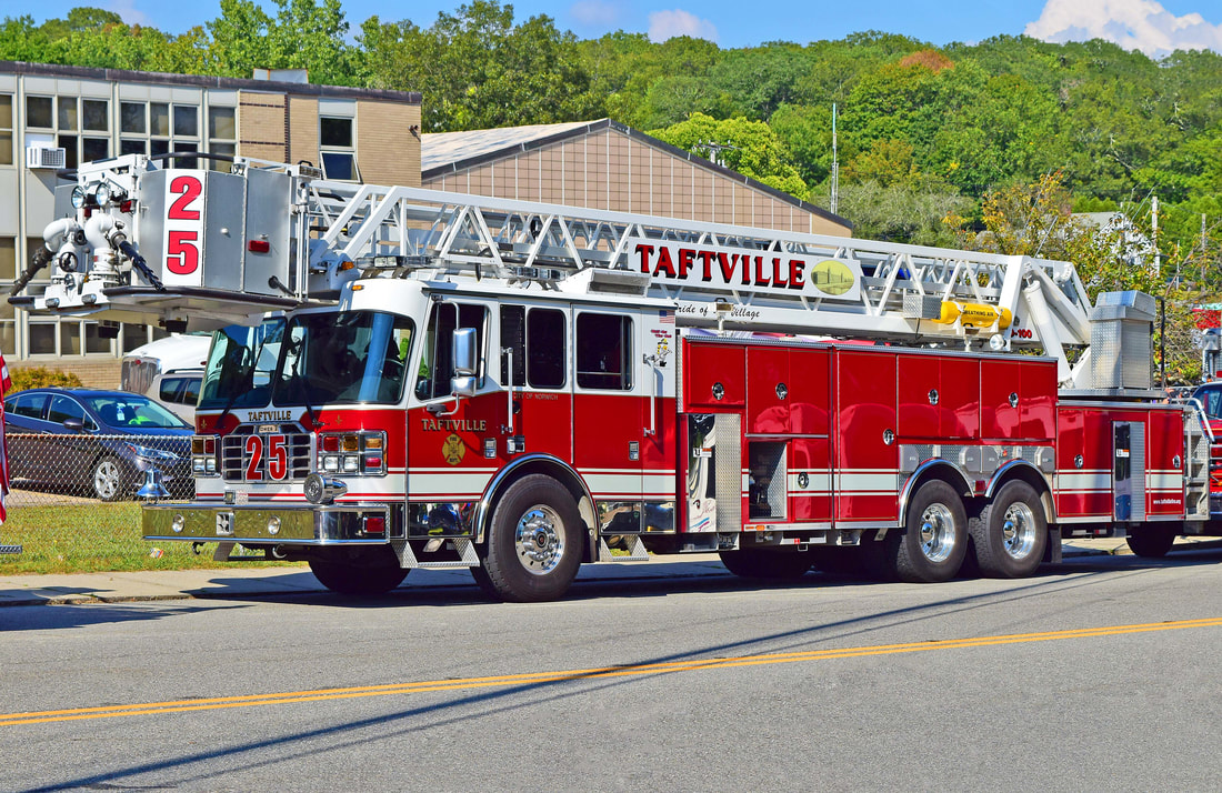 Taftville's Tower 25, a 2006 Ferrara 100ft RMA.
